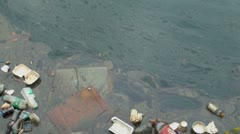 Litter Floating in Polluted Water Stock Footage