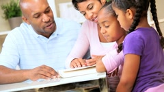 Little Ethnic Girl Reading to Family Stock Footage