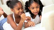 Little Ethnic Girls at Home Using Laptop Stock Footage