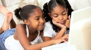 Little Ethnic Girls Playing on Laptop Stock Footage