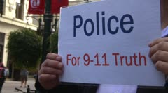Protest, Occupy (Wall-Street) Calgary, crowds and signs police 911 truth - stock footage