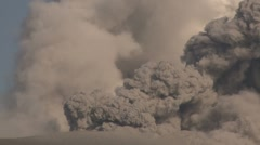 Ash And Steam Erupt From Kirishima Volcano Into Clear Blue Sky Stock Footage