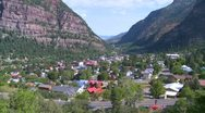A downtown establishing shot of Ouray, Colorado with steam train passing. Stock Footage