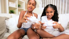 African American Girls Using a Games Console Stock Footage