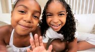 African American Children Using Online Web Chat Stock Footage