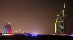 Time Lapse 1080p: Night hotels - Burj Al Arab and Jumeirah, United Arab Emirates Stock Footage