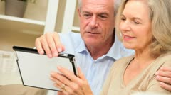 Mature Couple Enjoying Wireless Tablet Technology Stock Footage