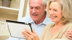 Caucasian Senior Couple at Home with a Wireless Tablet Stock Footage