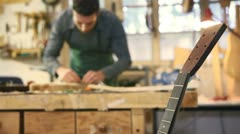 Italian artisan working in lutemaker workshop Stock Footage