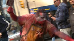 Zombie walk, undead butcher waving cleaver Stock Footage