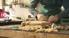 Italian artisan at work in lutemaker workshop Stock Footage