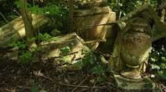 Nunhead Gothic Victorian cemetery, London, track past fallen headstones Stock Footage