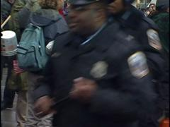 DC Police run past, not in riot gear. Stock Footage