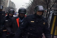 Police line walk towards camera, DC riot police Stock Footage