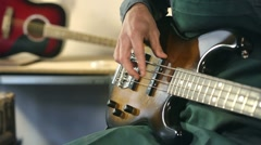 Italian craftsman in workshop playing custom bass guitar Stock Footage