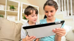 Young Caucasian Siblings with Wireless Tablet - stock footage