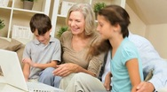 Children and Grandparents Using Laptop Computer Stock Footage