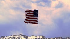 United States flag waving in the breeze at dawn. Stock Footage