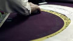 Shuffling card trick on a purple table. - stock footage
