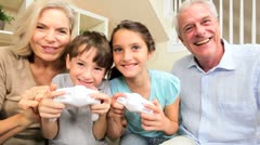 Family Generations Playing on Games Console Stock Footage