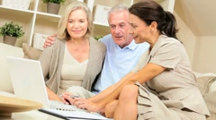 Financial Advisor Meeting with Senior Clients at Home Stock Footage
