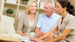 Senior Couple Meeting with Financial Advisor Stock Footage