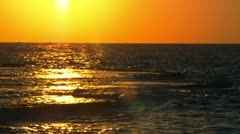 Sunset reflected in the Mediterranean at Dor Beach in Israel Stock Footage