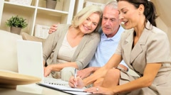Senior Clients Meeting with Financial Advisor at Home Stock Footage