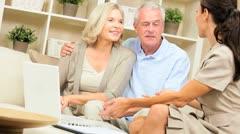 Senior Couple Meeting with Financial Advisor - stock footage