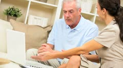 Financial Advisor with Senior Client at Home - stock footage