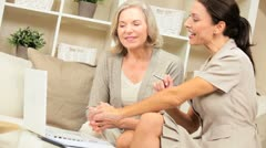Financial Advisor with Senior Female Client at Home Stock Footage