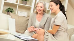 Senior Female Meeting with Financial Advisor Stock Footage