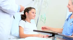 Young Girl Being Treated by Hospital Doctor - stock footage