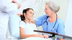 Doctor and Nurse Examining Young Patient in Hospital Stock Footage