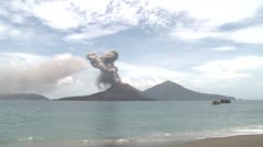 Tropical Beach And Erupting Volcano - stock footage