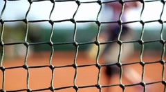 Tennis Net with Tennis Player in the Background Stock Footage