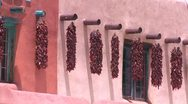 Stock Video Footage of Chili peppers hang outside a New Mexico building.
