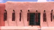 Stock Video Footage of Chili peppers hang outside a New Mexico building in Taos.