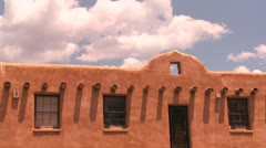 Time lapse clouds above a New Mexico adobe building. Stock Footage