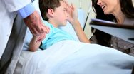 Stock Video Footage of Mother and Doctor Reassuring Little Boy in Hospital