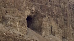 A cave in a cliff face Stock Footage