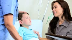Young Child Patient with Clinic Nurse - stock footage