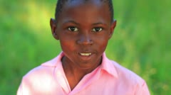 Little jumpy Kenyan boy smiling. Stock Footage