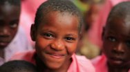 Stock Video Footage of Other Kids smiling into the camera in Kenya.