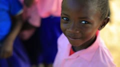 Another Young Kenyan girl starting to smile and laugh. - stock footage