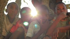 More Children sitting in a tree looking at the camera in Kenya. - stock footage