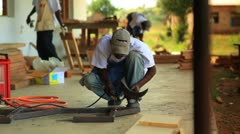 Construction by a metal worker in a Kenyan village. - stock footage