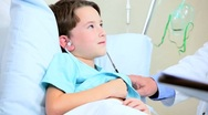 Young Caucasian Boy in Hospital Bed Stock Footage