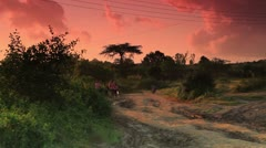 People in the morning bustle in a Kenyan village. Stock Footage