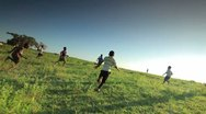 Stock Video Footage of African Youth playing soccer on the fields in Kenya.